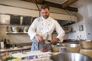 Jonathon Chiri preparing food in kitchen