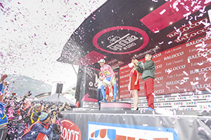 Alberto Contador on podium spraying champagne